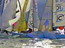 J/80s sailing around leeward mark