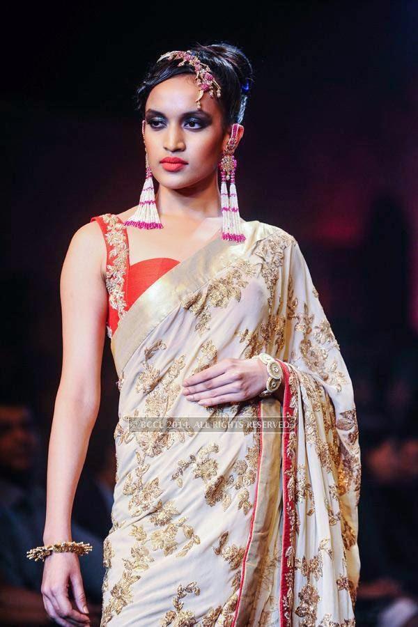 A model walks the ramp for Bridhichand Ghanshyamdas Jewellers on Day 3 of India International Jewellery Week (IIJW), 2014, held at Grand Hyatt, in Mumbai.