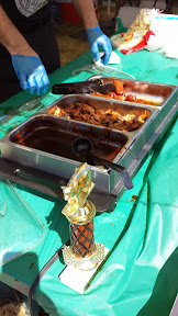 Sausage and pork for sampling at one BBQ team's booth