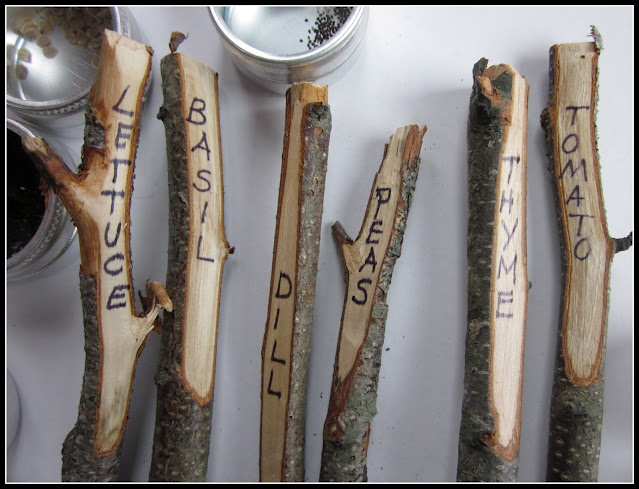 Row of stakes with plant names