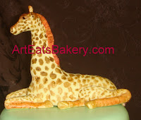 Hand made sugar sculpture giraffe figure cake topper