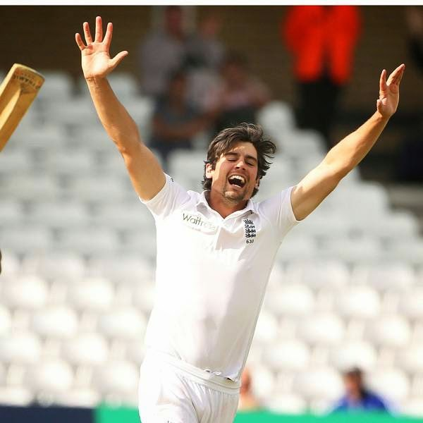 England captain Alastair Cook (R) celebrates after taking the wicket of India's Ishant Sharma on the final day of the first cricket Test match between England and India at Trent Bridge in Nottingham, central England on July 13, 2014.