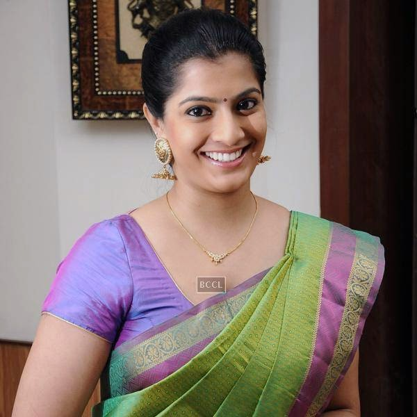Varalakshmi Sarathkumar is all smiles for the cameras during the movie pooja of Thaarai Thappattai, held in Chennai.