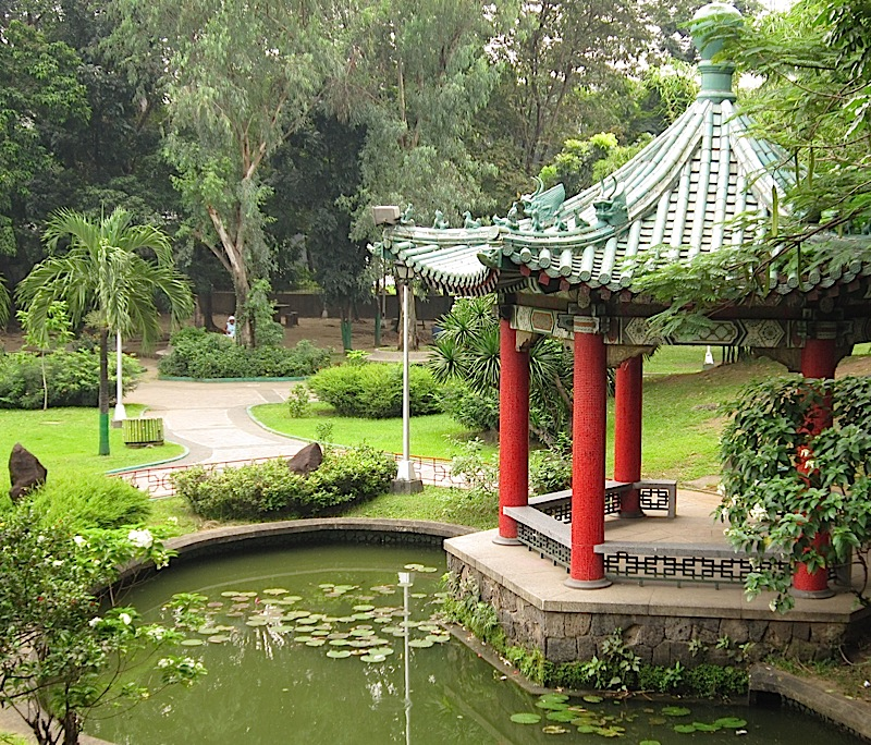 Chinese gazebo beside a pond in the Chinese Garden of the Rizal Park