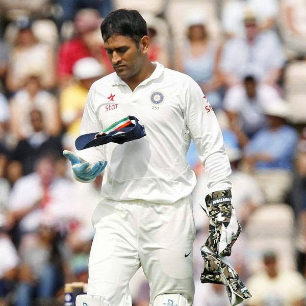 India's Captain and wicketkeeper MS Dhoni reacts in the field during play on the first day of the third cricket Test match between England and India at The Ageas Bowl cricket ground in Southampton on July 27, 2014.