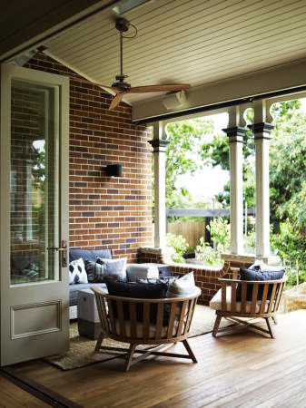 Tuck-pointed brickwork and  wooden floorboards retained with original verandah posts and attractive furniture
