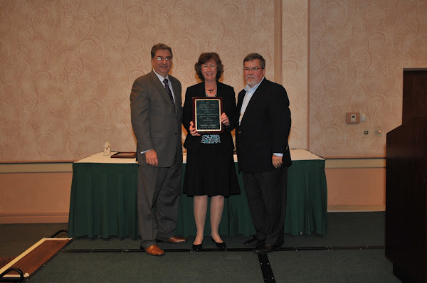 Patricia Folan, Director of the Tobacco Control Center at North Shore-Long Island Jewish Health System, receives Honorable Mention for the 2011 Community Health Improvement Award. Handing out the award are HANYS President Daniel Sisto (left) and Joseph McDonald, President and Chief Executive Officer of Catholic Health System (right).