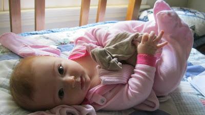 Karina playing on bed