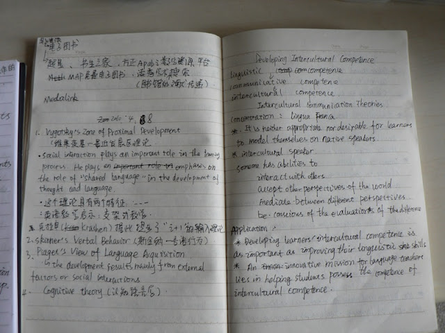 open notebook with notes in both Chinese and English