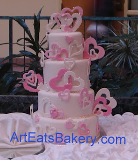 Modern Four Tier Pearl Sheen Round Wedding Cake With Curve Designs Fondant Butterflies