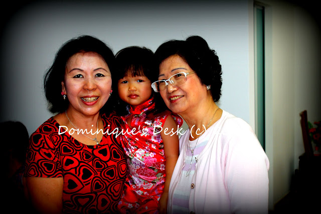 Tiger girl with both her grandmothers.