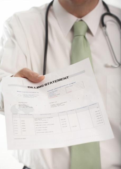 Doctor Holding Medical Bill