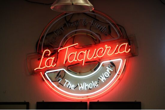 The sign at La Taqueria puts their (fairly accurate) boasting in neon.