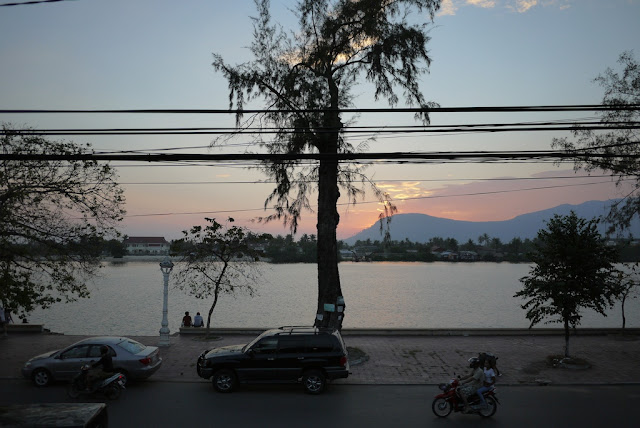 second story view of a river and mountains in Kampot, Cambodia