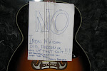 Scotty left Al a note on his acoustic