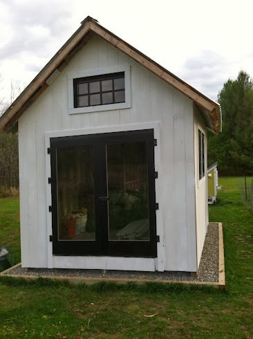 White shed with black doors and windows