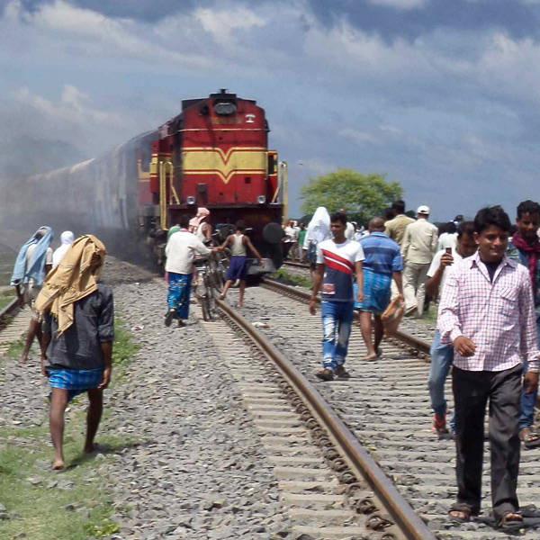 A speeding express train ran over devotees waiting on tracks to stop it, leaving 35 people dead.