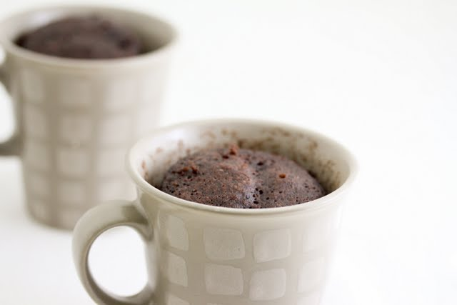 close-up photo of a chocolate mug cake with one in the background