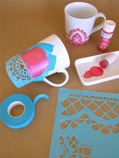 Stencilling on the mugs...we used our foam pouncer to apply pearl paint over the taped-on stencil.