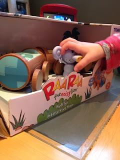 Blake opening Raa Raa the noisy lion's Huffty's train toy set