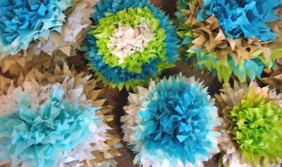 Blue and gold tissue paper scraps with scissors