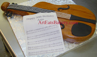 Unique 3D realistic violin custom birthday cake with edible sheet music