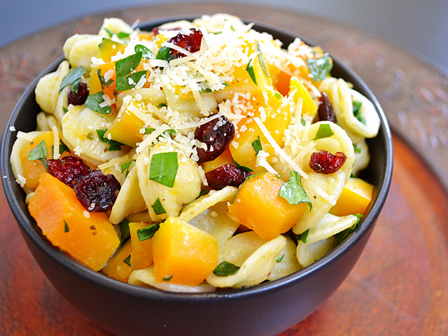 close up of butternut squash pasta salad in small bowl