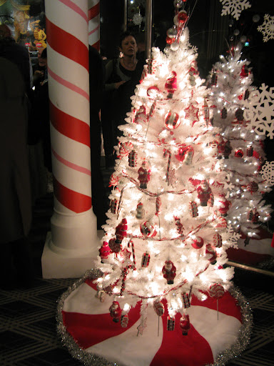 The peppermint tree skirts were all handmade, then trimmed with tinsel. I like the column—transformed into a peppermint stick!