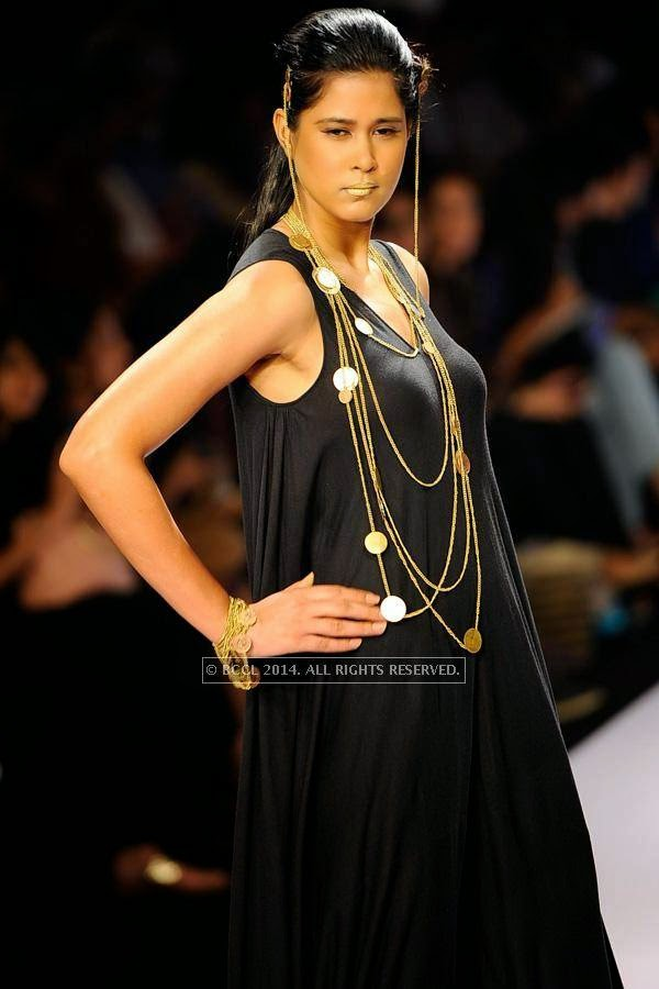 A model showcases a creation by NID on Day 3 of India International Jewellery Week (IIJW), 2014 at Grand Hyatt, Mumbai.