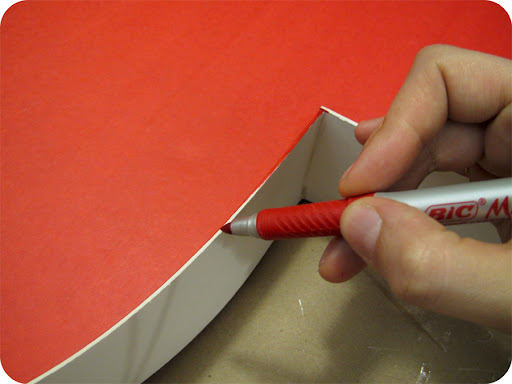 With a red marker, color in the top white edge of the mat board.