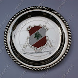 The presidential crest impressed on a silver plated plate.