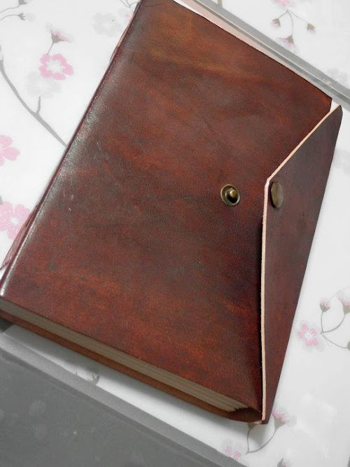 Leather-bound sketchbook with acid-free 100% cotton made papers bought from an eBay UK seller