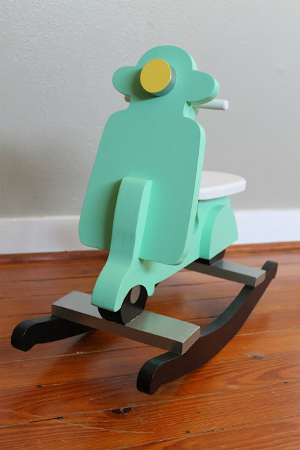 toddler-sized wooden rocking scooter