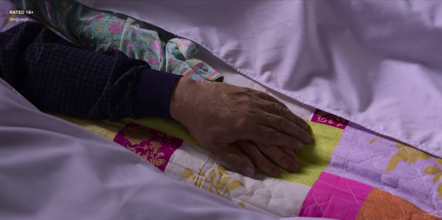 Tow hands put together over a blanket
