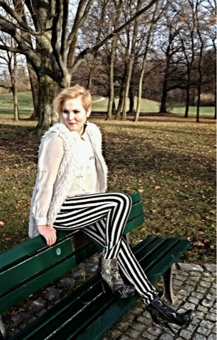 How to style striped pants and a furry jacket