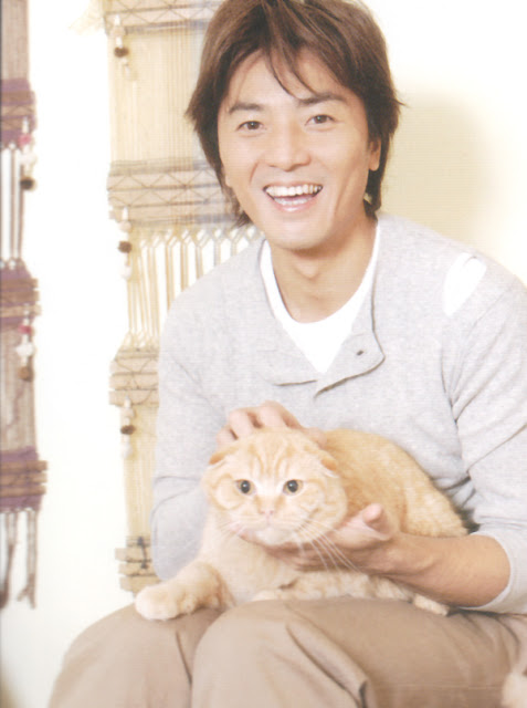 Ekin Cheng and an orange cat