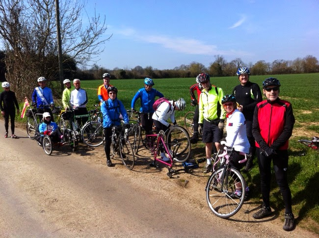 Fourteen cyclists in the sun