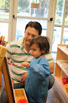 Toddlers have fun painting at easels just their size.