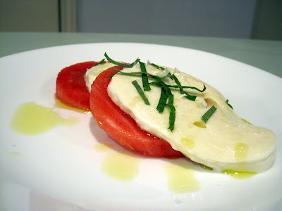 Fresh mozzarella with watermelon, mint, olive oil and flaky salt.