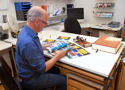 Willem de Vink looks through his comic book