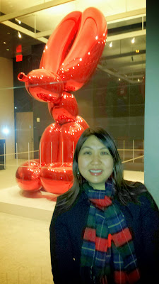 Red Rabbit by Jeff Koons, the father of shiny balloon dog sculptures (he does them in 5 Colors- Blue, Magenta, Yellow, Orange, Red) at 51 Astor Place.  It is a 4 feet tall, 6,600 pound mirror-polished stainless steel sculpture. There are four (Magenta, Blue, Yellow, Violet) others in the world