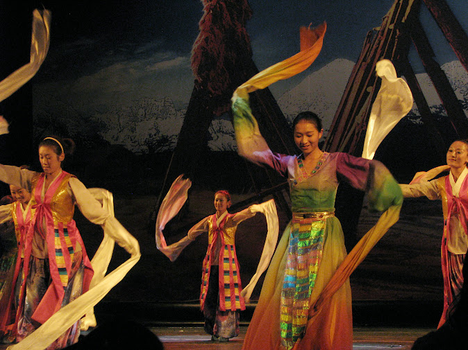 Ladies dancing in colorful costumes at the Shangri-La Cultural Show (2012)