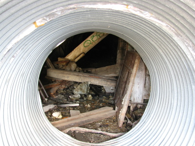 inside one of the metal tubes that help close off the shaft