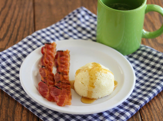 photo of Pancake Mug Cake on a plate with bacon