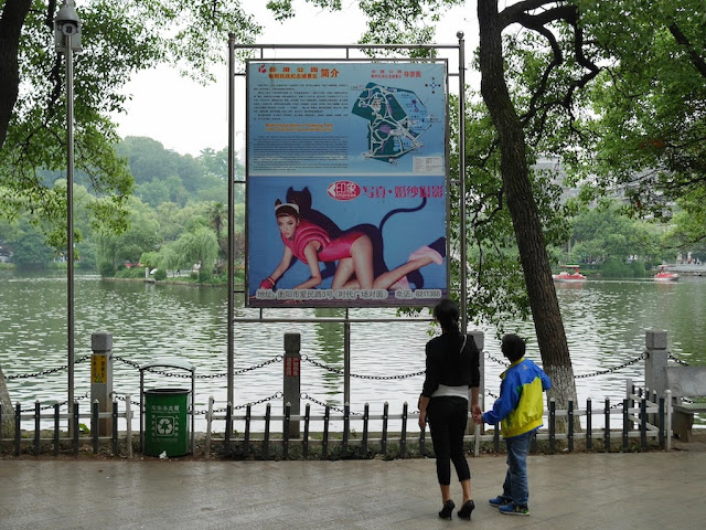 map for Yueping Park above an ad with a woman wearing a cat outfit