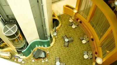 The hotel has a nice tall lobby