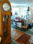 Tall grand polished clock & polished floors in antique emporium