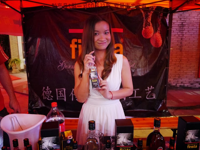 young woman holding a bottle of finsta alcohol