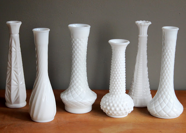 Tall milk glass vases available for rent from www.momentarilyyours.com, $1.00 each.