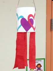 we made cute valentine windsocks another quick easy craft just use a 4 12 by 18 piece of construction paper decorate with hearts